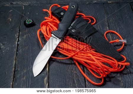 Knife Of The German Army. A Military Knife On An Orange Paracord Cord.