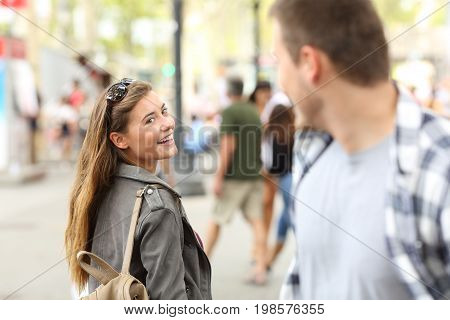 Casual girl in love meeting her crush on the street