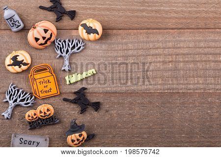 Assortment of small halloween decorations on a wood surface