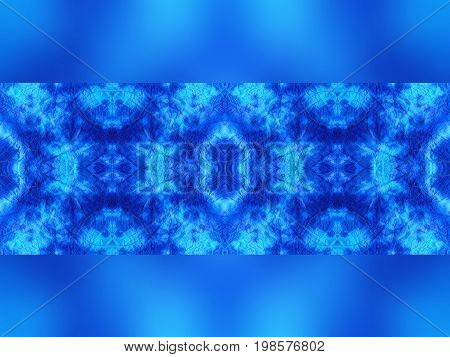 Hand-dyed blue and turquoise fabric with zig zag stitch detail and in a seamless repeat pattern with a band of blurred fabric on the top and bottom edge with space for text.