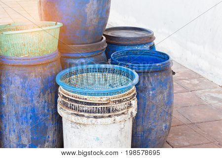 dirty white and blue garbage bin with copyspace on the right