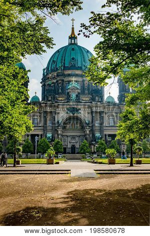 Berlin Cathedral Berliner Dom, Germany through the trees of Lustgarten park