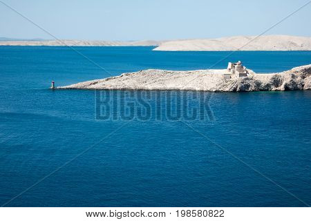 Ruins of ancient Fortress Fortica on island Pag, Croatia. The fort served to defend trade and vessels in medieval times