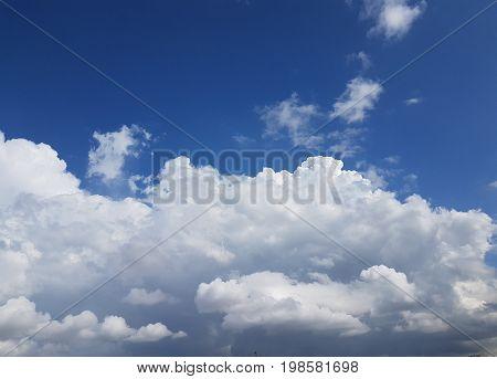 Full frame of huge white clouds forming over blie sky background