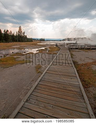 Boardwalk Leading To Hot Lake Geyser Hot Spring In The Lower Geyser Basin In Yellowstone National Pa