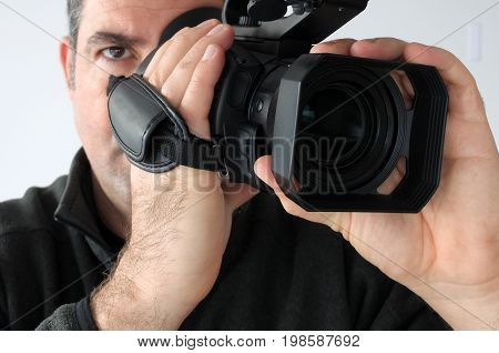 Cameraman Shooting Footage With Video Camera