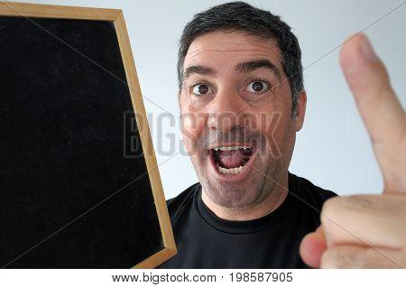 Man Holds Empty Blackboard Having An Idea