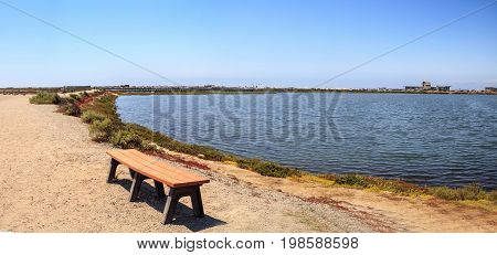 Bench Overlooking The Peaceful And Tranquil Marsh Of Bolsa Chica Wetlands