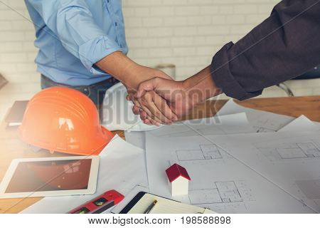 Engineer And Architect Concept, Engineer Architects Office Team Working Shaking Hand With Blueprints