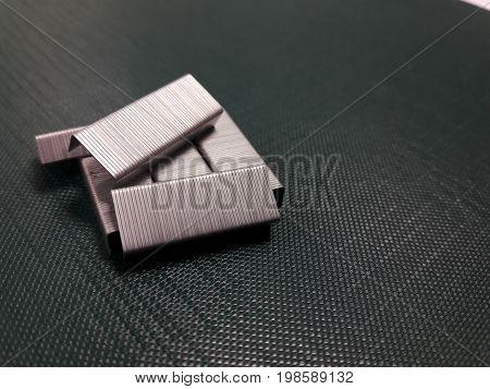 Many staples no.10 on dark green cardboard