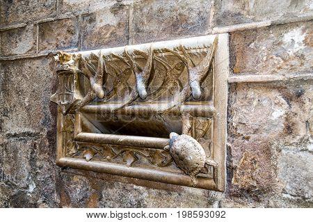 Medieval mailbox at La Casa de l'Ardiaca in Barcelona Spain.