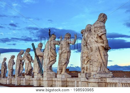 ROME, ITALY - JANUARY 18, 2017 Christ Disciples Statue Saint Peter's Roof Vatican Rome Italy. Christ and disciples on Vatican roof. Saint Matthew Gospel Writer symbol axe.