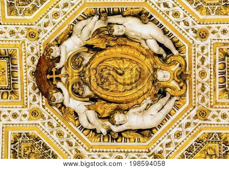 ROME, ITALY - JANUARY 18, 2017 Angels Golden Dragon Ceiling Saint Peter's Basilica Vatican Rome Italy. Vatican and ceiling built in 1600s