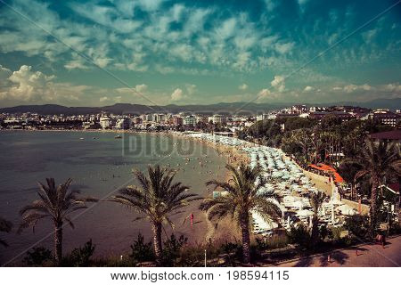 AVSALLAR TURKEY - JUNE 30 2015: The coastline and relax on the beach. Anatolian coast - a popular holiday destination in summer of European citizens. Vintage toning. Stylization.