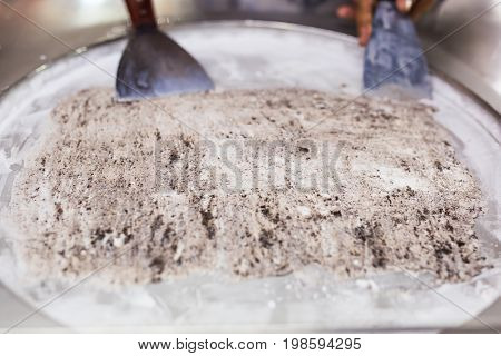 Thailand stir-fried ice cream rolls at freeze pan. Organic, natural rolled ice cream, hand made dessert