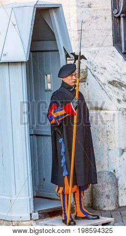 ROME, ITALY - JANUARY 18, 2017 Colorful Swiss Guard Saint Peter's Basilica Vatican Rome Italy. De Facto Military of the Vatican with the responsibility of protecting the Pope since the 1400s