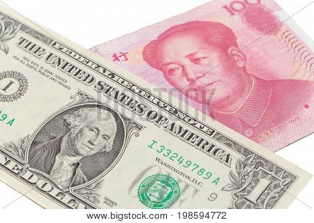 US dollar bill and Chinese yuan banknote on white background USA and Chinese exchange rate concept.