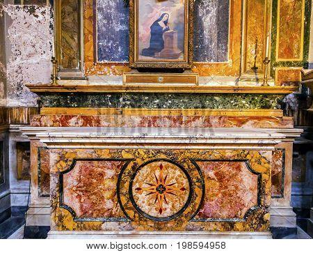 ROME, ITALY - JANUARY 18, 2017 Stone Altar SS Vincenzo E Anastasio Church Basilica Dome Trevi Rome Italy. Vincenzo Anastasio Church is Baroque Church built in the 1600s next to Trevi fountain.