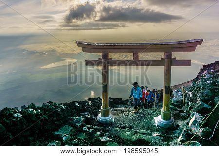 MOUNT FUJI YAMANASHI JAPAN - July 25 2017 : Torii on top of Fuji mountain . Fuji is highest mountain in Japan at 3776 m symbol of Japan .