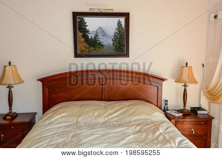 Beautiful bedroom with table lights on bedside tables beside the bed