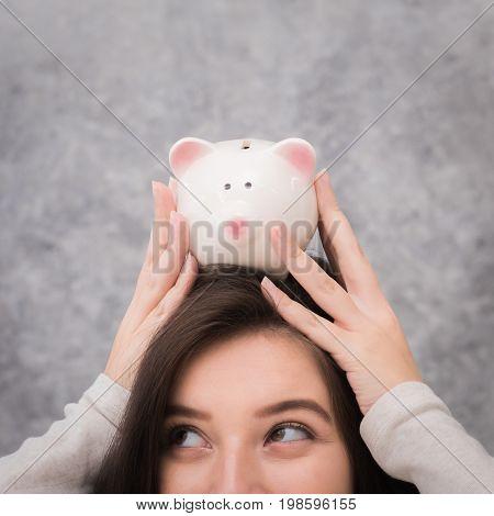 Beautiful young girl saving money for holiday season saving money concept