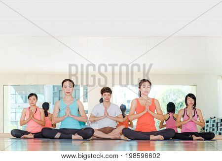 Yoga Class In Studio Room,group Of People Doing Namaste Pose With Calm Relax Emotion,meditation Pose