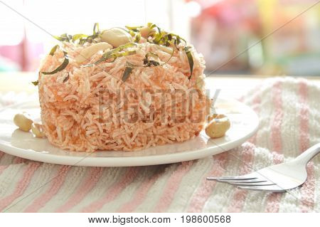 crispy fried vermicelli noodles with coconut cream topping peanut and slice lemon leaf on plate