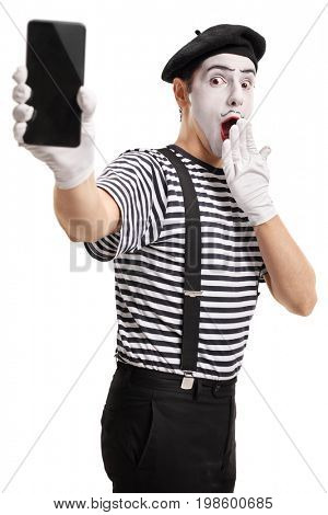 Surprised mime artist showing a phone isolated on white background