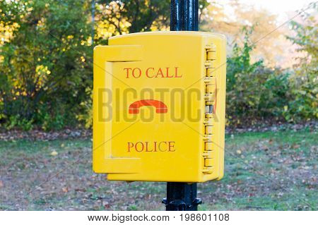 emergency call police yellow box in a New-York city park, USA