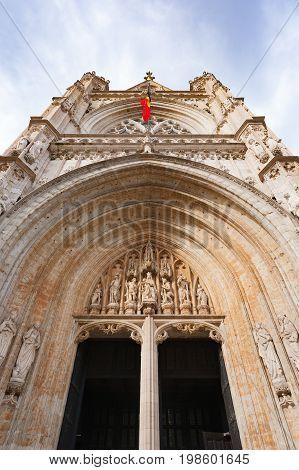 Gate and sculptures of Notre-Dame au Sablon in Brussels against sky, Belgium