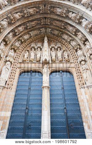 Gate and sculptures of Notre-Dame au Sablon in Brussels, Belgium
