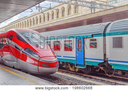 Modern high-speed passenger train stand on the railways station.