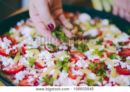 Raw Pizza Dough With Sauce And Ingredients On Wooden Table. Fresh O Raw Pizza, Preparation In Tradit