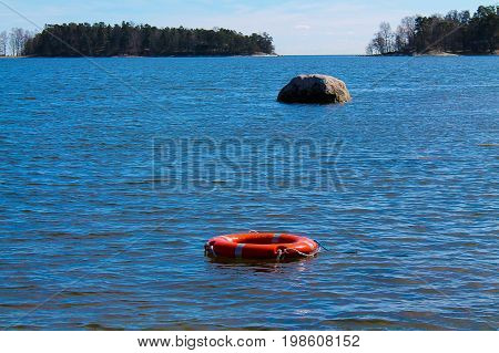 A life ring floating in the water