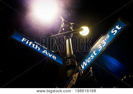 Light Post And Fifth Avenue Street Sign On The Corner Of The West 33Rd Street In Manhattan, New York