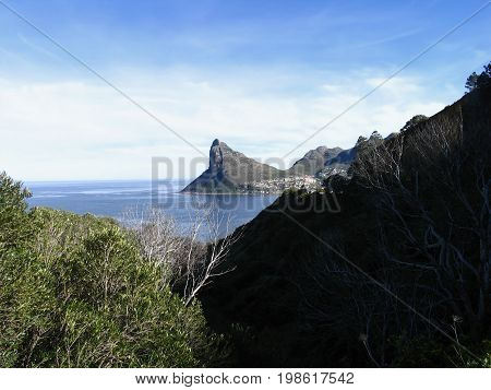VIEW OF SENTINEL PEAK IN HOUT BAY IN THE BACK GROUND, FROM LOOKOUT POINT, CHAPMANS PEAK, CAPE TOWN, SOUTH AFRICA