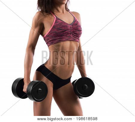 Cropped shot of stunning hot sexy body of an athletic woman in sports top and shorts. Sportswoman lifting dumbbells isolated on white sport determination power strength fitness concept.