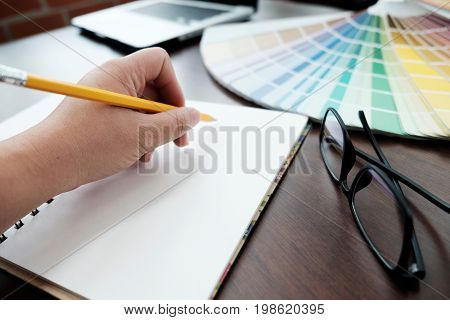 Graphic Design And Color Swatches And Pens On A Desk. Architectural Drawing With Work Tools And Acce