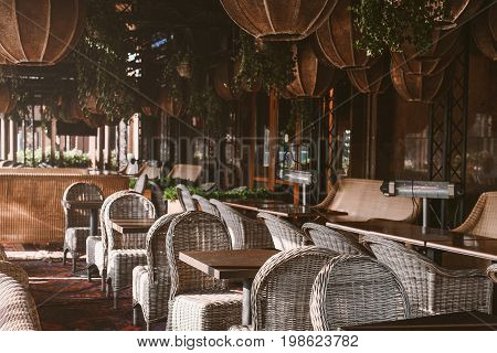 Wooden table and chair in emoty cafe morning