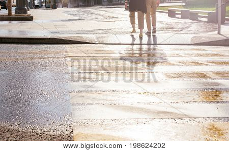 Persons silhouette walking on the pedestrian way. Man passing the road in early morning
