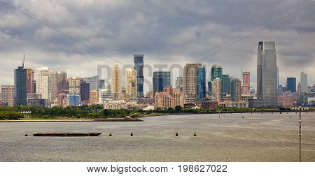 The skyline of Jersey City New Jersey from New York Harbor