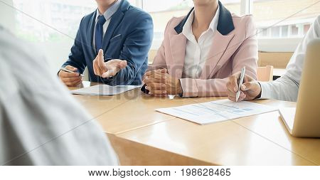 Business Concept. Business Team With Documents Having Discussion In Office