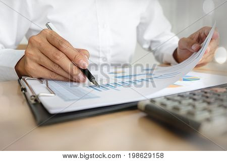 Businesswoman Working At His Coffee Shop And Using Laptop, Holding Glasses In Hand Discussing The Ch