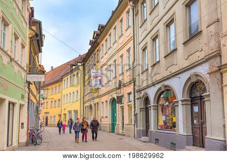 Bamberg, Germany - February 19, 2017: Bamberg city center street view with colorful houses and people
