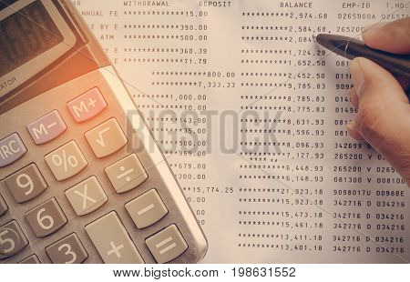 Calculator on Statement with hand writing account receivable and payable for saving money