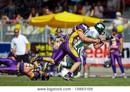 VIENNA,  AUSTRIA - MAY 10: Austrian Football League:  WR Thomas Haider (#13, Dragons) and the Danube Dragons  beat the Vienna Vikings 24:27 on May 10, 2009 in Vienna, Austria.
