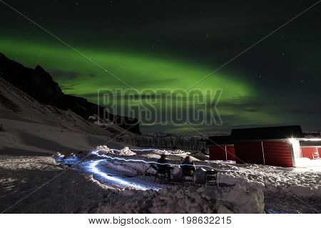 Aurora Borealis with light effects, people sight seeing Aurora lights in Iceland