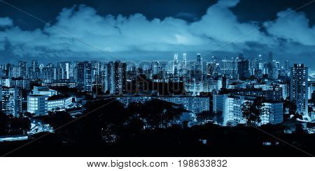 Singapore skyline viewed from mt faber at night with urban buildings
