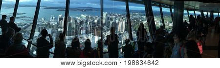 AUCKLAND - AUG 03 2017:Visitors at Auckland's Sky Tower observation deck. In 2016 Auckland hosted a record total of 2.217 million international visitors.