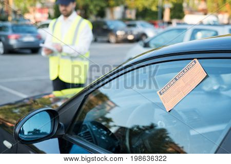 Police Officer Giving A  Fine For Parking Violation